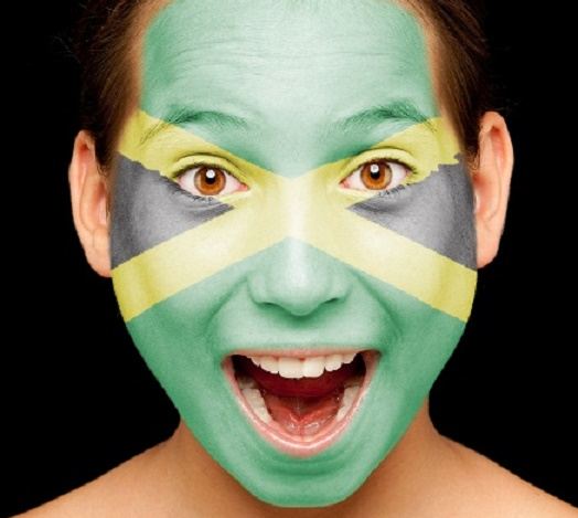 girl with jamaican flag painted on her face